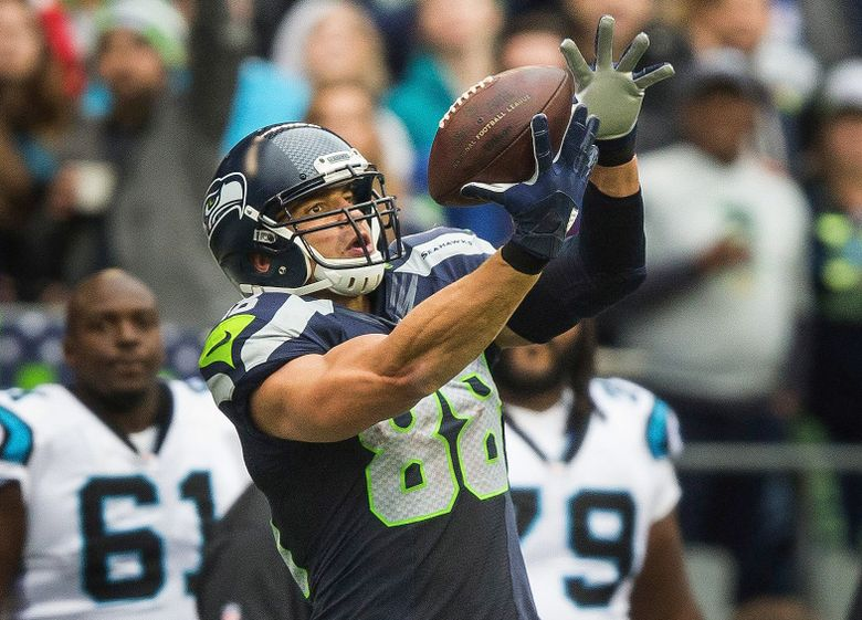 Jimmy Graham pulls in the pass from Russell Wilson, good for 45 yards down to the Panthers' 33-yard line in the fourth quarter Sunday at CenturyLink Field. (Dean Rutz/The Seattle Times)