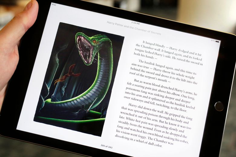 """Text and an illustration from """"Harry Potter and the Chamber of Secrets"""" are displayed on an iPad, Wednesday, Sept. 30, 2015, in New York. The J.K. Rowling books are being released with animated or interactive illustrations, but only through Apple's iBooks Store and require the use of an Apple mobile device or a Mac computer. (AP Photo/Mark Lennihan)"""