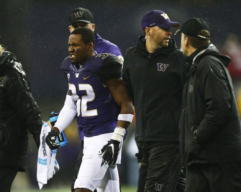 Washington defensive back Budda Baker winces as he comes off the field after being shaken up on a play during the game against Utah at Husky Stadium in Seattle on Saturday, Nov. 7, 2015. Utah led Washington 24-13 at the half.  (Lindsey Wasson / The Seattle Times)
