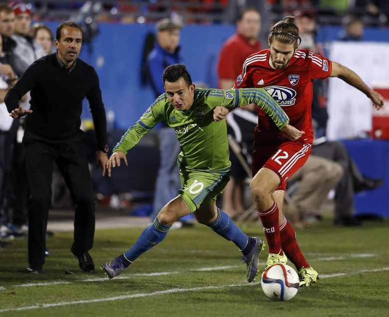 Seattle Sounders FC midfielder Marco Pappa (10) battles with FC Dallas midfielder Ryan Hollingshead (12) during the overtime period of an MLS soccer western conference semifinal playoff match Sunday, Nov. 8, 2015, in Frisco, Texas. Dallas won 4-2 on penalty kicks.  (Brad Loper / The Associated Press)