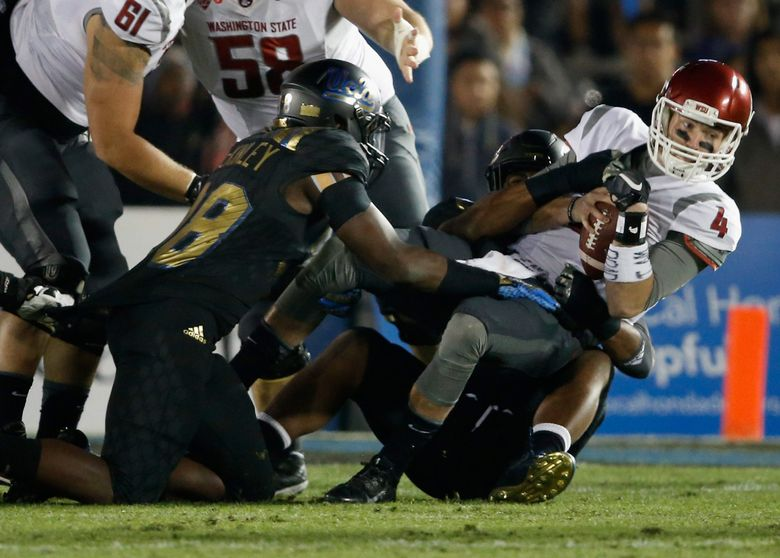 Luke Falk (4) of the Washington State Cougars is sacked by Takkarist McKinley (98) of the UCLA Bruins during the first quarter of a game at Rose Bowl on November 14, 2015 in Pasadena, California.   (Sean M. Haffey / Getty Images)