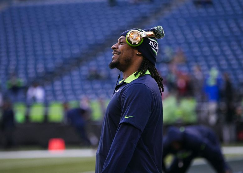 Seahawks running back Marshawn Lynch warms up before Seattle's game against the Arizona Cardinals on Nov. 15 at CenturyLink Field. (Bettina Hansen / The Seattle Times)