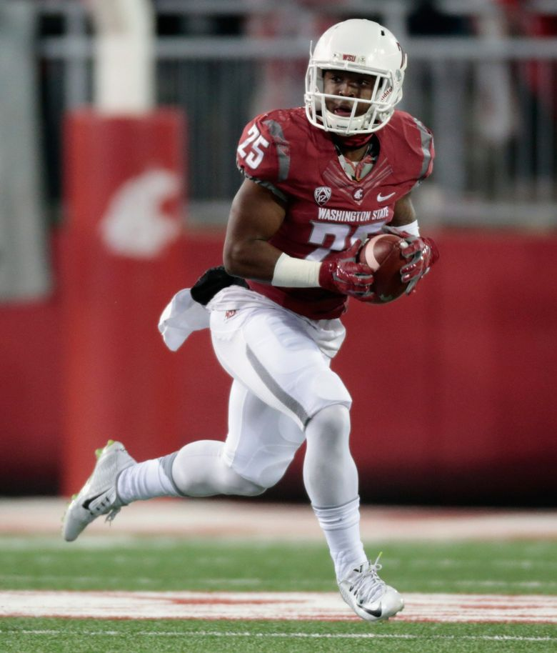 Jamal Morrow #25 of the Washington State Cougars carries the ball against the Colorado Buffaloes in the first half at Martin Stadium on November 21, 2015 in Pullman. (William Mancebo / Getty Images)