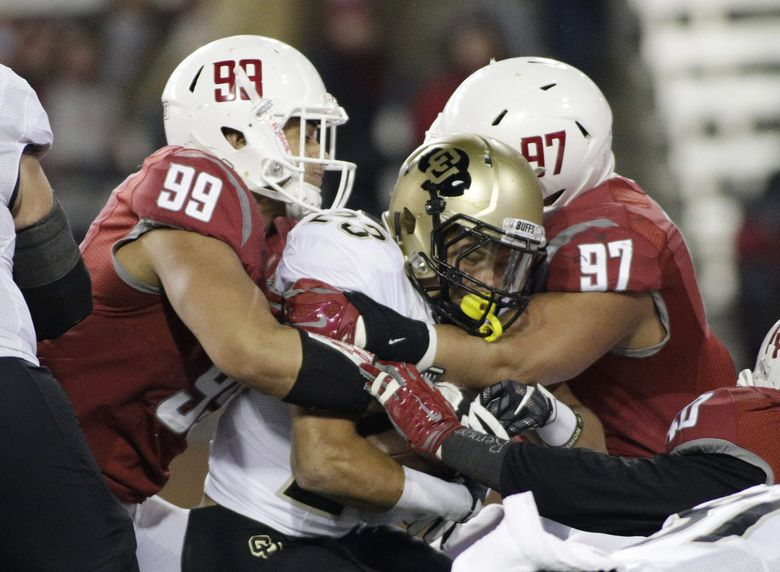 Washington State defensive linemen Darryl Paulo (99) and Destiny Vaeao (97) take down Colorado running back Phillip Lindsay (23) during the first half. (AP Photo/Young Kwak)