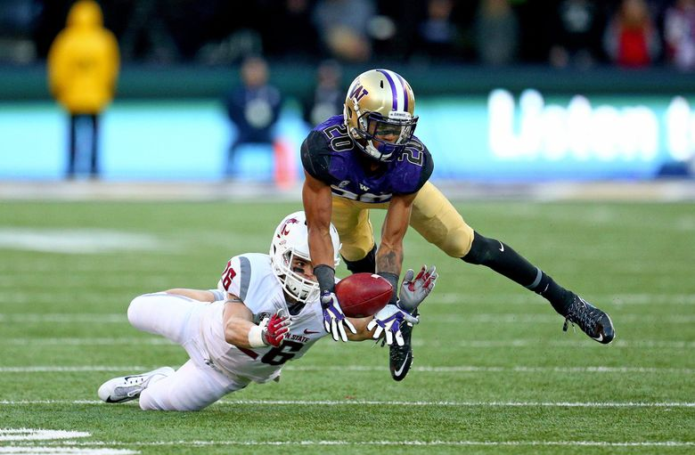 Washington defender Kevin King nearly intercepts a pass intended for Washingotn State's Tyler Baker in the second half .   (John Lok / The Seattle Times)