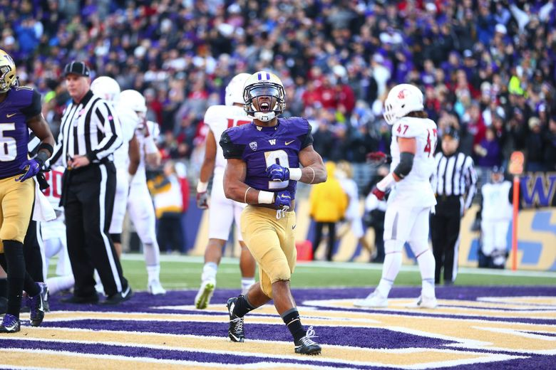 Washington running back Myles Gaskin celebrates his touchdown run against Washington State in the second half of the Apple Cup on Nov. 27, 2015, in Seattle. (John Lok / The Seattle Times)