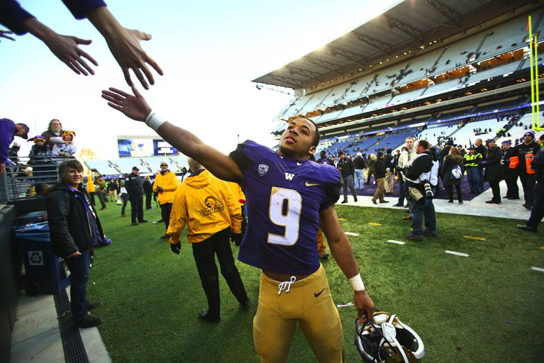 Washington running back Myles Gaskin greets the cheering crowd after defeating Washington State 45-10 at the 108th Apple Cup at Husky Stadium on Nov. 27, 2015, in Seattle.  (John Lok / The Seattle Times)