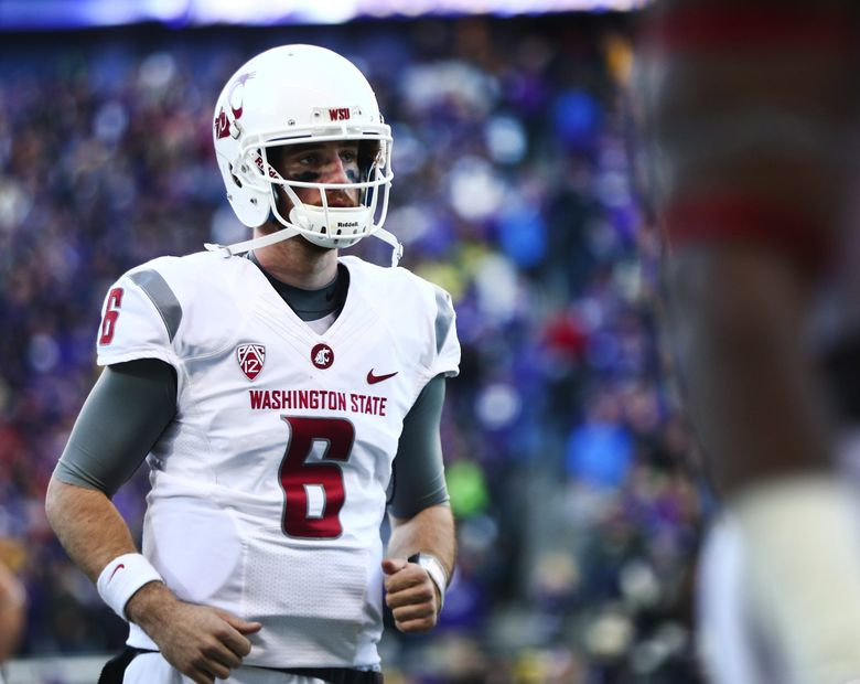 Washington State quarterback Peyton Bender (6) comes off the field after being intercepted in the fourth quarter by Washington linebacker Azeem Victor, who returned the ball for a touchdown during the 108th Apple Cup at Husky Stadium on Friday, Nov. 27, 2015. Washington beat Washington State 45-10.   (Lindsey Wasson / The Seattle Times)