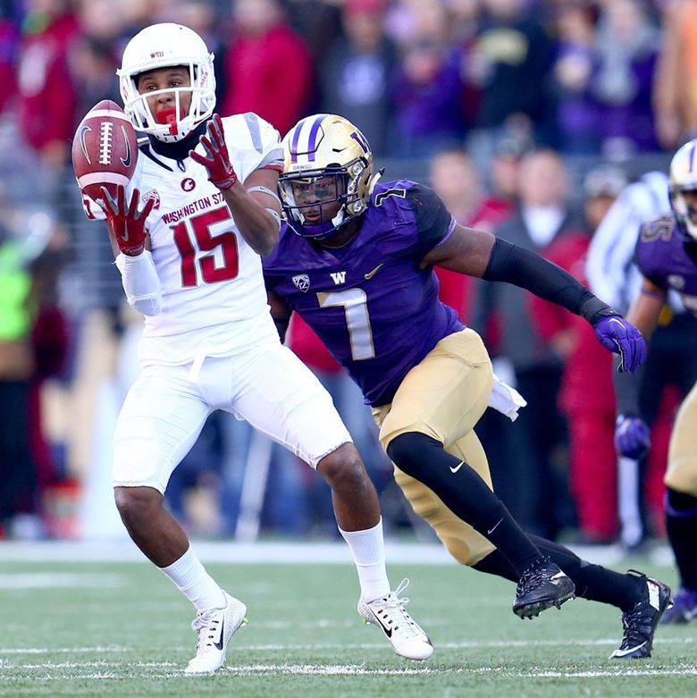 Washington State's Robert Lewis pulls in a pass for a 3-yard gain as Washington's Keishawn Bierria closes in on him  in the first quarter  during Apple Cup at Husky Stadium Friday, Nov. 27, 2015.  (JOHN LOK/THE SEATTLE TIMES / )