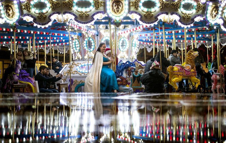 The Westlake Park Holiday carousel downtown is open every day from Nov. 27 until Jan. 1.  (Lindsey Wasson / The Seattle Times)