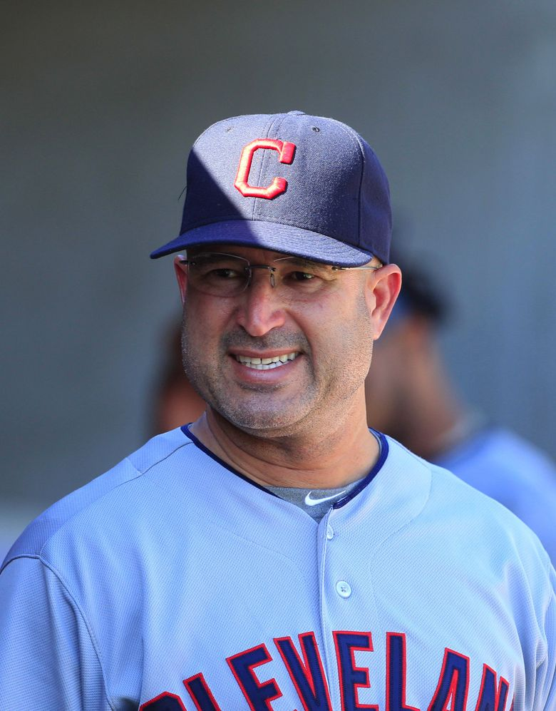 Cleveland Indians manager Manny Acta is seen in the dugout during the tenth inning of a baseball game against the Detroit Tigers in Detroit, Sunday, Aug. 5, 2012. (AP Photo/Carlos Osorio)
