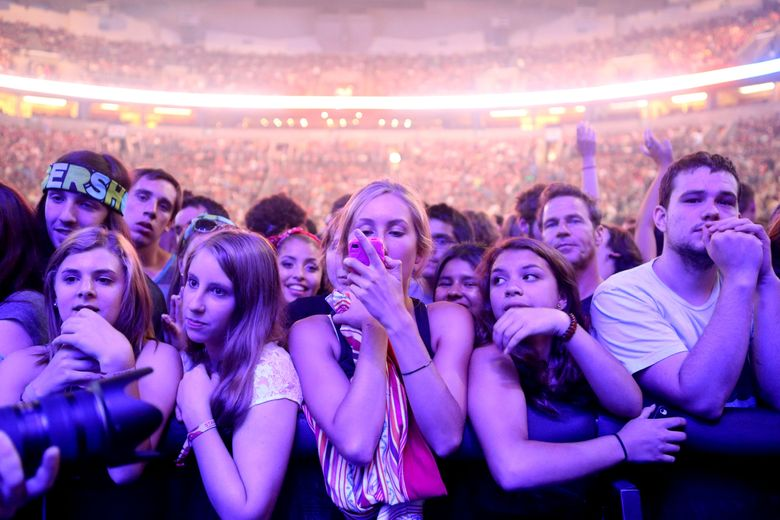 Fans enjoy Death Cab For Cutie at Bumbershoot three years ago. The band is headlining the festival again in 2016. Weekend passes go on sale at 10 a.m. Friday, April 29. (Bettina Hansen / The Seattle Times)