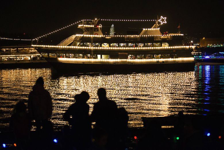 The Argosy Christmas Ships pass the Mercer Island Beach Club.  (LINDSEY WASSON/THE SEATTLE TIMES)