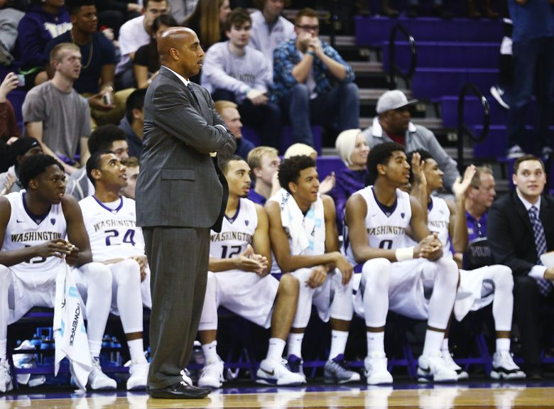 Washington coach Lorenzo Romar watches the action during the second half of an exhibition game.  (Lindsey Wasson/The Seattle Times)