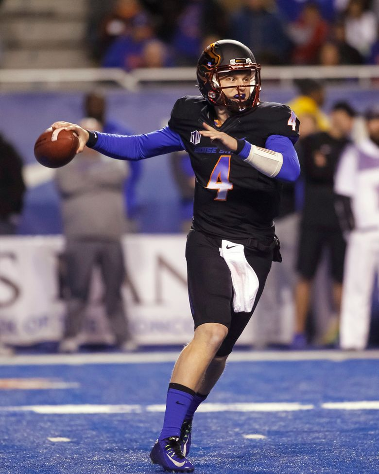 Boise State quarterback Brett Rypien (4) looks for a receiver during the first half of an NCAA college football game against New Mexico in Boise, Idaho, on Saturday, Nov. 14, 2015. (AP Photo/Otto Kitsinger)