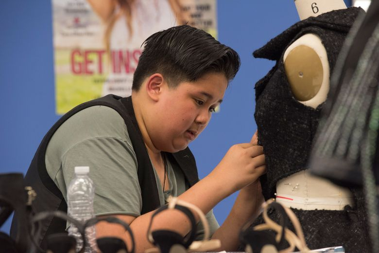 """A contestant works on a design during the inaugural season of """"Project Runway: Junior,"""" premiering Thursday, Nov. 12, on Lifetime. The designers are all between 13 and 17 years old."""