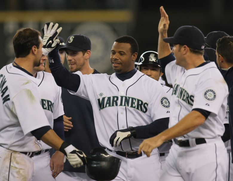 Ken Griffey Jr., who played for the Mariners two different times, is shown after a game-winning hit for Seattle in 2010. (Jim Bates / The Seattle Times)
