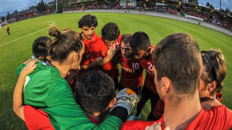 The Seattle University men's soccer team prepares for last year's match against Washington at Championship Field. (Wilson Tsoi)