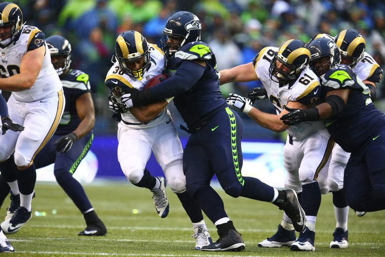 Ahtyba Rubin, here making a tackle against the Rams, has agreed to a three-year deal to stay with the Seahawks. (John Lok / The Seattle Times)