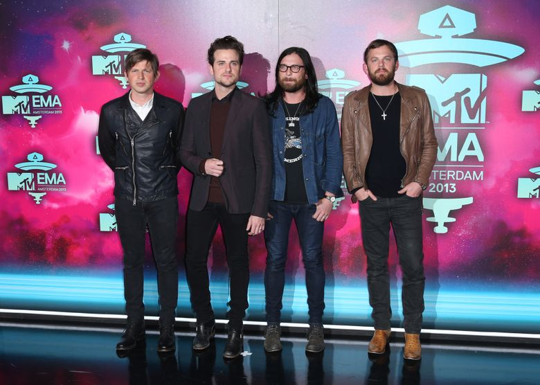 """FILE – In this Nov. 10, 2013 file photo, from left, Matthew Followill, Jared Followill, Nathan Followill and Caleb Followill of the band Kings of Leon pose for photographers upon arrival at the 2013 MTV Europe Music Awards, in Amsterdam, Netherlands. The Kings of Leon took it easy this year after finishing up their international tour for their 2013 album """"Mechanical Bull,"""" but the Grammy-winning family rock group is ready to start 2016 with a bang, literally. They are headlining the New Year's Eve celebrations in downtown Nashville, Tenn., where they've made their home for 15 years. (Photo by Joel Ryan/Invision/AP, File)"""