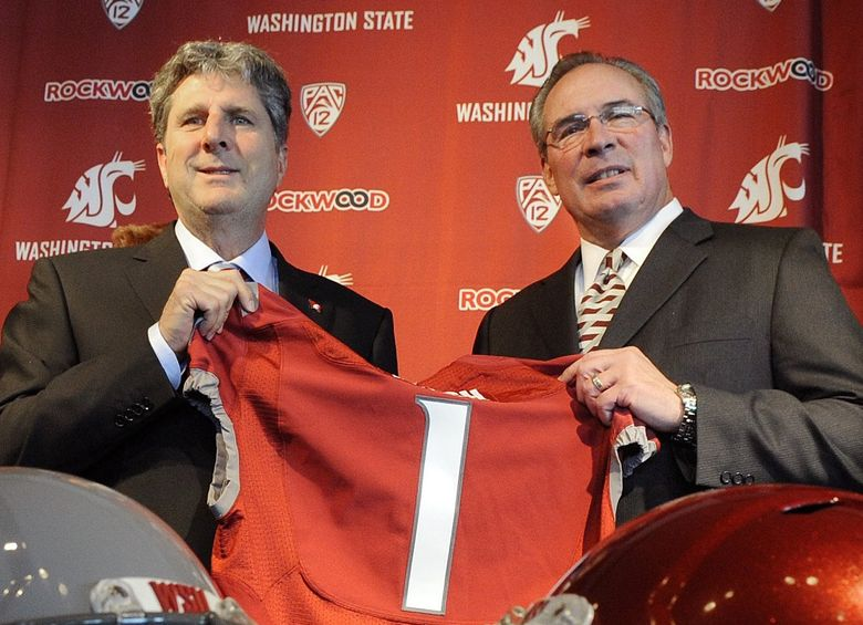 Washington State athletic director Bill Moos, right, and new head football coach Mike Leach hold up a jersey during a news conference Tuesday, Dec. 6, 2011. (Christopher Anderson/The Spokesman-Review)