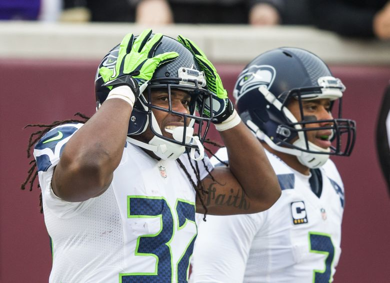 Seahawks running back DuJuan Harris can't believe a holding call will negate a 50-yard touchdown run by Russell Wilson, in background, during the third quarter of Seattle's 38-7 victory over the Minnesota Vikings on Dec. 6 at TCF Bank Stadium in Minneapolis. (Dean Rutz / The Seattle Times)