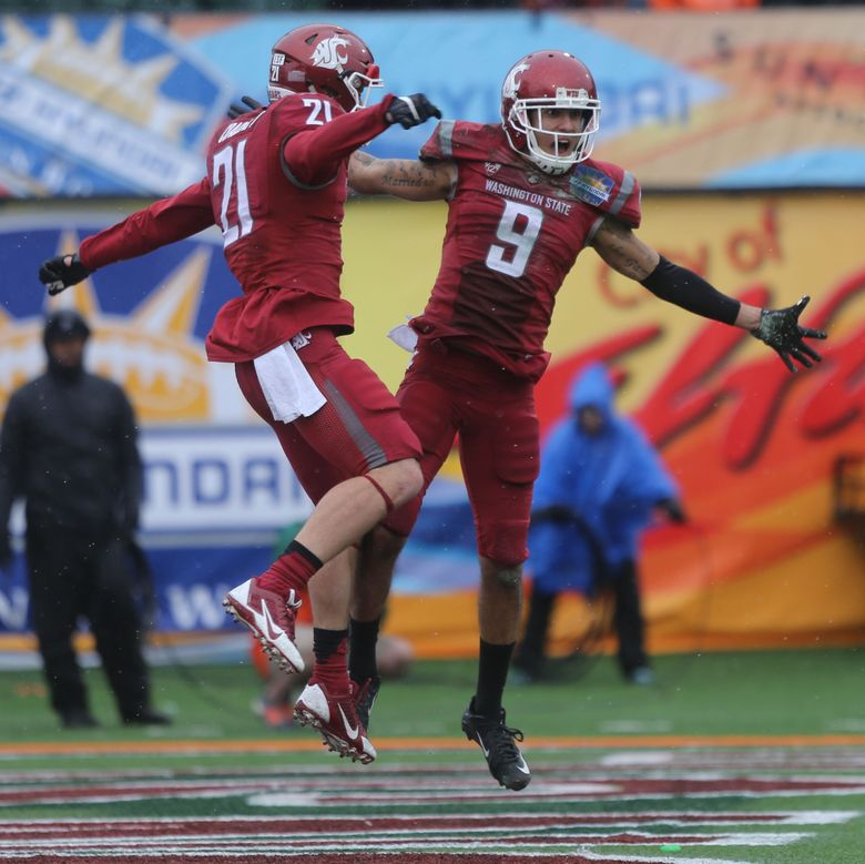 Washington State receiver Gabe Marks, right, celebrates with teammate River Cracraft after scoring a touchdown during the first half of the Sun Bowl NCAA college football game against Miami, Saturday Dec. 26, 2015 in El Paso, Texas. (Victor Calzada/AP)