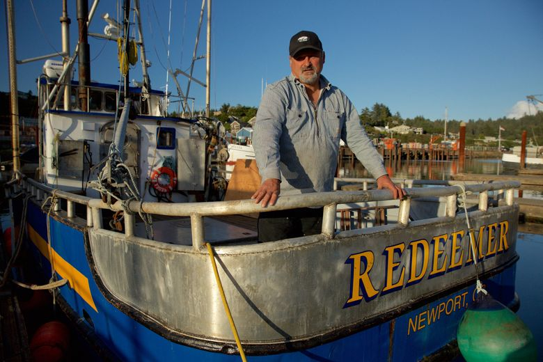 """This photo provided by courtesy of  Discovery shows Captain Gary Ripka standing on his boat, the FV Redeemer, at the dock in Newport, Ore., the setting of """"Deadliest Catch: Dungeon Cove,"""" airing in the fall of 2016 on Discovery.  (Discovery via AP)"""