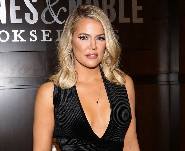 """FILE – In Monday, Nov. 9, 2015 file photo, Khloe Kardashian poses for a photo at the book-signing for her new book """"Strong Looks Better Naked,"""" at Barnes & Noble The Grove in Los Angeles. Kardashian is behind a new makeover series at the E! network, where she promises to help the brokenhearted get the """"ultimate payback."""" E! said Wednesday, Dec. 16, it had approved a six-episode series where Kardashian will be the mentor for people trying to turn their life around. (Photo by John Salangsang/Invision/AP, File)"""