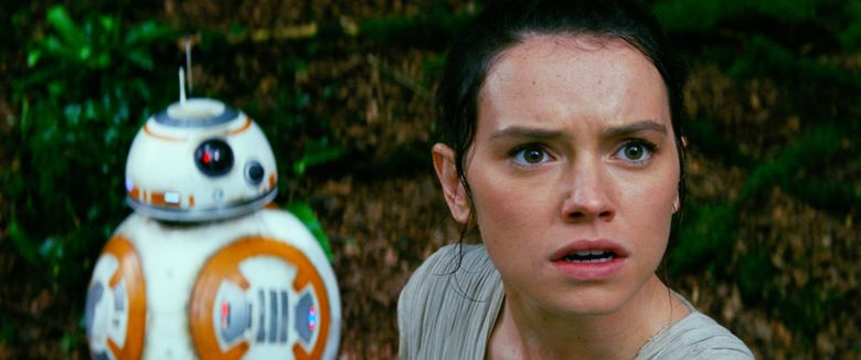 """This photo provided by Disney/Lucasfilm shows Daisy Ridley, right, as Rey, and BB-8, in a scene from the film, """"Star Wars: The Force Awakens,"""" directed by J.J. Abrams. The movie opens in U.S. theaters on Friday, Dec. 18, 2015.  (Film Frame/Disney/Lucasfilm via AP)"""