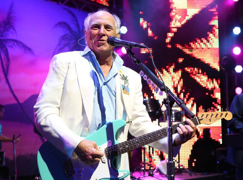 """FILE – In this June 9, 2015 file photo, Jimmy Buffett performs at the after party for the premiere of """"Jurassic World"""" in Los Angeles. Producers said Thursday, Dec. 17,  that a planned Jimmy Buffet musical will have Buffett's blend of rock and country tunes and an original story by writers Greg Garcia and Mike O'Malley. A world premiere production is expected to be announced for 2017. (Photo by Matt Sayles/Invision/AP, File)"""