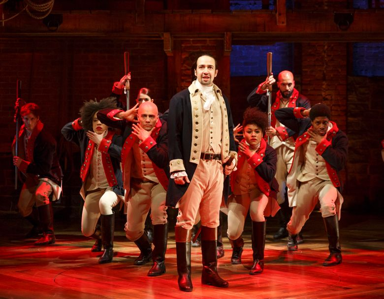 """This image released by The Public Theater shows Lin-Manuel Miranda, foreground, with the cast during a performance of """"Hamilton,"""" in New York. Another milestone has fallen thanks to the Broadway musical """"Hamilton"""" – this time on Twitter. The microblogging website said Monday, Dec. 21, 2015, that there have been over 1 million tweets about the hip-hop show featuring the life of nation's first treasury secretary. (Joan Marcus/The Public Theater via AP)"""