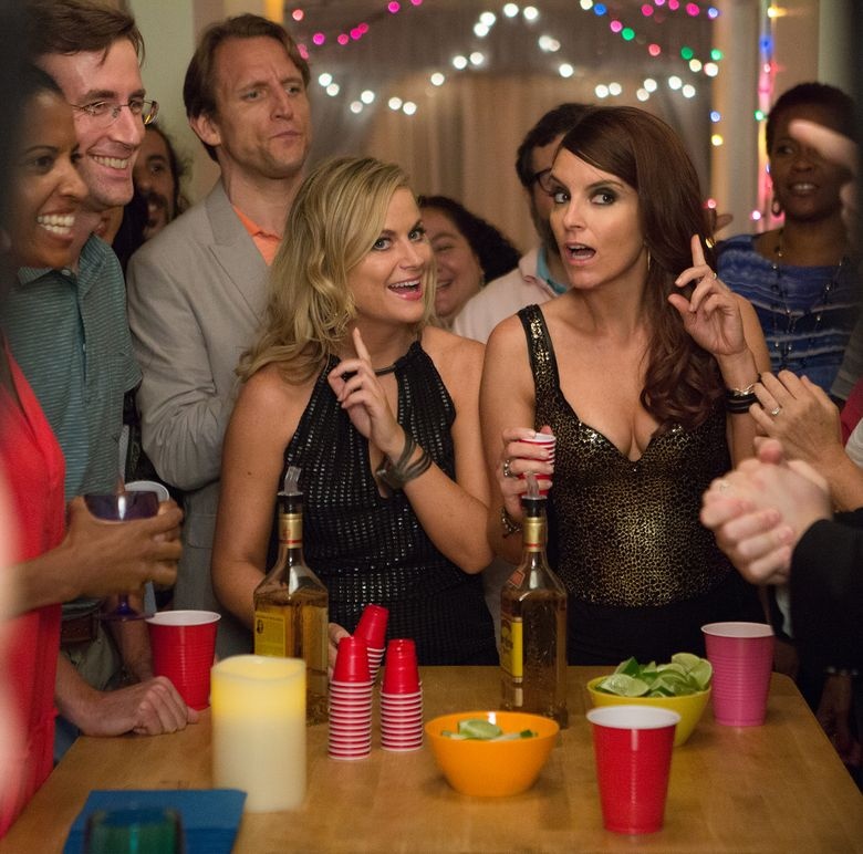 """Amy Poehler, left, and Tina Fey liven things up as siblings who decide to throw one last bash at their childhood home in """"Sisters."""" (Photo Credit: K. C. Bailey/Copyright:  2015 Universal Stu)"""