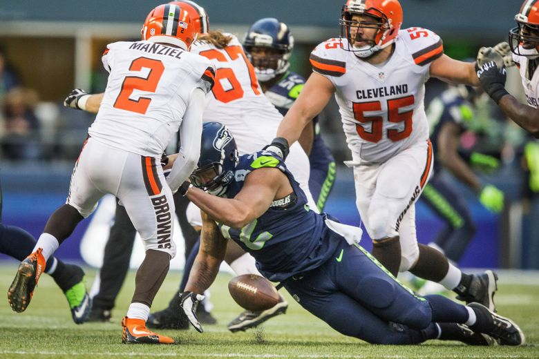 Michael Bennett forces a fumble by Cleveland quarterback Johnny Manziel in the 4th quarter that the Browns would recover. The Cleveland Browns played the Seattle Seahawks Sunday, December 20, 2015, at CenturyLink Field in Seattle. (Dean Rutz/The Seattle Times)