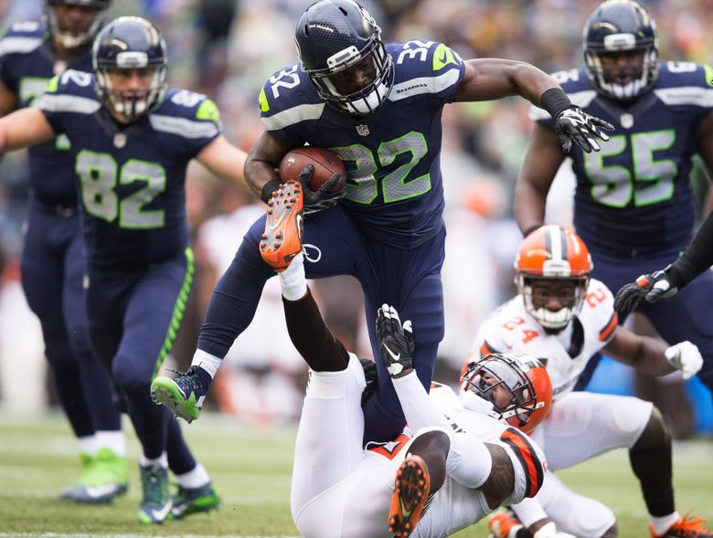 Seahawks running back Christine Michael picks up 6 yards in the second quarter at CenturyLink Field, Sunday, Dec. 20, 2015. (Dean Rutz/The Seattle Times)