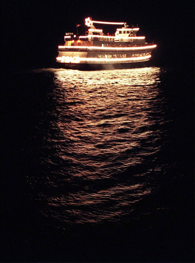 Illuminated boats will join to form a floating parade through Seattle's Fremont Cut, beginning at 8 p.m. Friday Dec. 18.  (Teresa Tamura/The Seattle Times)