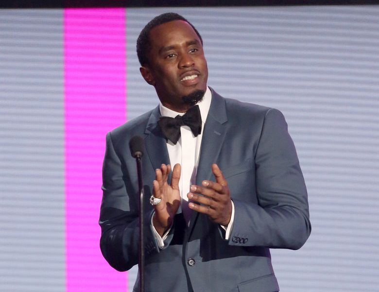 """FILE – In this Nov. 22, 2015 file photo, Sean Combs presents an award at the American Music Awards in Los Angeles. The veteran music mogul expects to perform on """"Pitbull's New Year's Resolution"""" concert on Fox and will rerelease his recent critically-acclaimed mixtape """"Money Making Mitch"""" through iTunes on Friday. It's the prequel to Puff Daddy's final album """"No Way Out 2,"""" which will release next year. (Photo by Matt Sayles/Invision/AP, FIle)"""