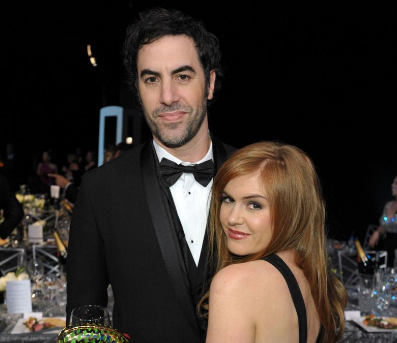 FILE – In a Sunday Jan. 27, 2013 file photo, Sacha Baron Cohen, left, and his wife Isla Fisher pose in the audience at the 19th Annual Screen Actors Guild Awards at the Shrine Auditorium in Los Angeles. Actors Sacha Baron Cohen and his wife Isla Fisher are donating $1 million to Save the Children and the International Rescue Committee to support victims of the conflict in Syria. Save the Children has announced that one-half of the sum will fund a program vaccinating more than 250,000 children against a potential measles outbreak in Northern Syria. The other half of the donation will go toward supporting families, with a special concern for women and children, both inside Syria and in neighboring countries. That money will go toward education, health care, shelter and sanitation, Save the Children said.  (Photo by John Shearer/Invision/AP, File)