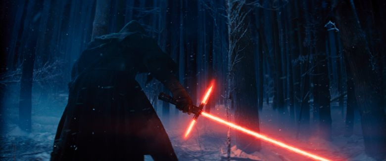 """This photo provided by Disney shows, Adam Driver as Kylo Ren with his Lightsaber in a scene from the new film, """"Star Wars: The Force Awakens."""" """"Star Wars"""" isn't just strong. It's unstoppable. The revival of the nearly 40-year-old space saga has already dominated the box office and toy shelves. Now, it's also been selected as The Associated Press Entertainer of the Year and is amassing support for Academy Awards consideration.   (Film Frame/Disney/Copyright Lucasfilm 2015 via AP)"""