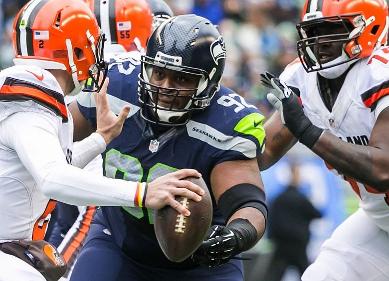 Seahawks defensive lineman Brandon Mebane gets his eyes on Browns quarterback Johnny Manziel to sack him in the first half as the Seattle Seahawks take on the Cleveland Browns at CenturyLink Field in Seattle Sunday December 20, 2015. (Bettina Hansen/The Seattle Times)