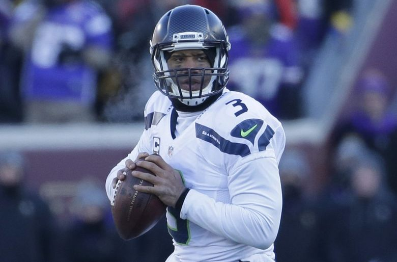 Seattle Seahawks quarterback Russell Wilson (3) scrambles during the first half. (Nam Y. Huh / The Associated Press)