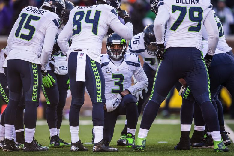 Russell Wilson huddles his offense in the 2nd half and tries to orchestrate a scoring drive.  The Seattle Seahawks played the Minnesota Vikings in the NFC Wild Card game Sunday, January 10, 2016 at TCF Bank Stadium in Minneapolis.  (Dean Rutz / The Seattle Times)