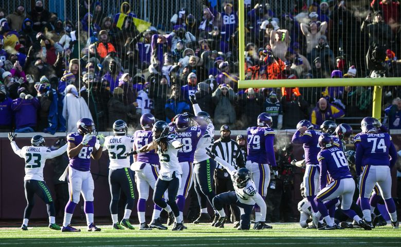 Seahawks cornerback Richard Sherman and teammates react after Vikings kicker Blair Walsh missed a final field goal. (Bettina Hansen / The Seattle Times)