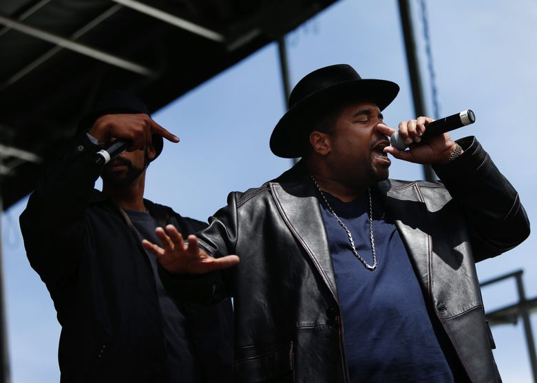 Sir Mix-A-Lot performs to a crowd of participants on the main stage at The South Fountain Lawn after the annual Rock 'n' Roll Marathon in Seattle in June 2014. (Lindsey Wasson / The Seattle Times)