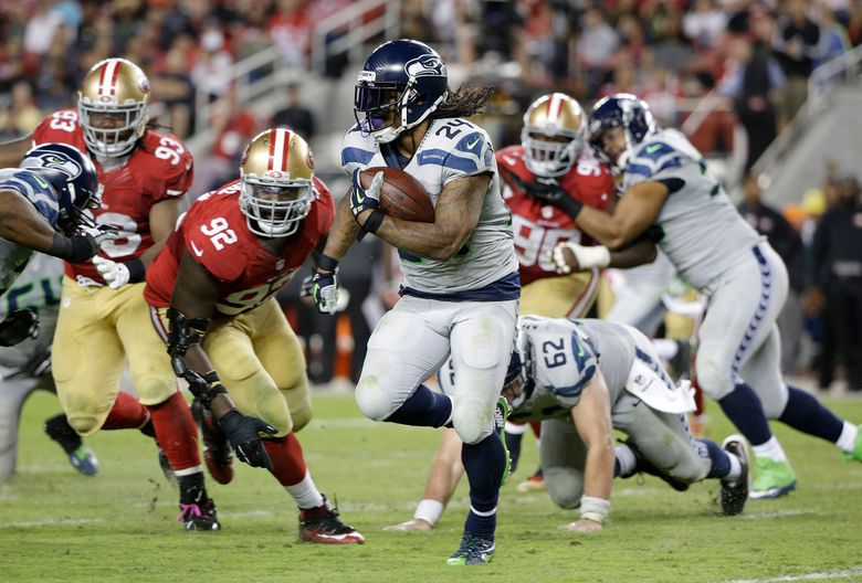FILE – In this Oct. 22, 2015, file photo, Seattle Seahawks running back Marshawn Lynch (24) runs against San Francisco 49ers defensive end Quinton Dial (92) during the second half of an NFL football game in Santa Clara, Calif. Marshawn Lynch has rejoined the Seattle Seahawks just in time for the playoffs. Coach Pete Carroll said on his radio show Monday morning, Jan. 4, 2016,  that Lynch was back at the team's facility after missing the final seven games of the regular season and undergoing abdominal surgery.  (AP Photo/Marcio Jose Sanchez, File)