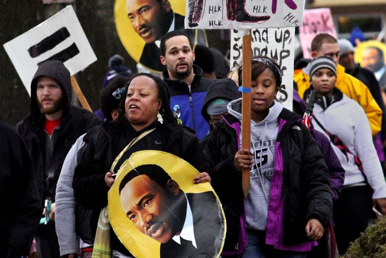 """Marchers at last year's """"Seattle Youth Unite for Justice, Restore the Dream"""" event. (Alan Berner/The Seattle Times)"""