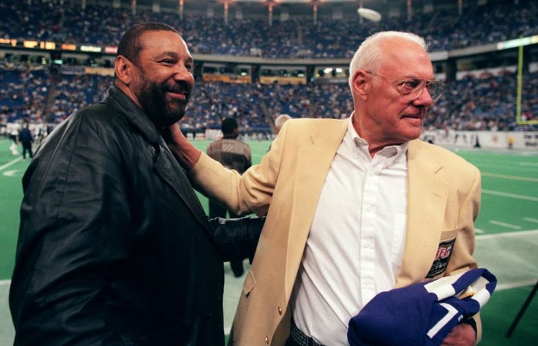 Vikings hall of fame coach Bud Grant shares a moment with Jim Marshall, Marshal's number 70 was retired before Sunday game against San Diego. (Star Tribune)