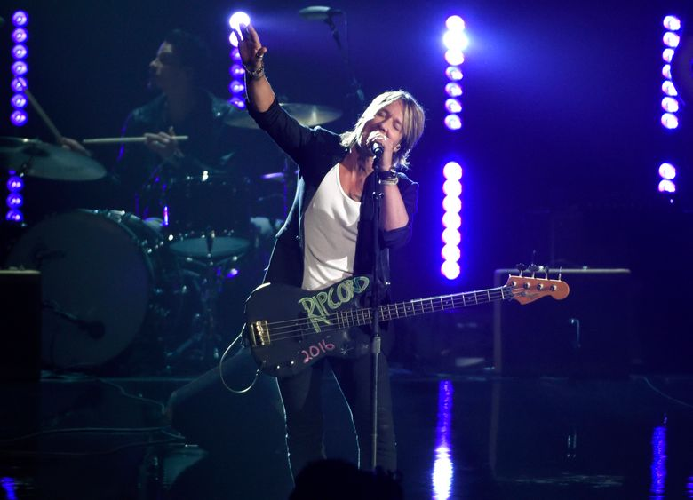 """FILE – In this Nov. 4, 2015, file photo, Keith Urban performs at the 49th annual CMA Awards at the Bridgestone Arena in Nashville, Tenn. Urban hasn't finished his forthcoming album, """"RipCORD,"""" but he's already planning a new arena and amphitheater tour in 2016. Urban announced on Monday, Jan. 11, 2016, the first leg of the RipCORD World Tour will start June 2 in Kansas City, Mo., and run through Nov. 19 at the Barclays Center in Brooklyn. (Photo by Chris Pizzello/Invision/AP, File)"""