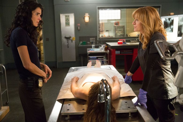 """This image released by TNT shows Angie Harmon, left, and Sasha Alexander in a scene from """" Rizzoli & Isles."""" TNT is ending the crime drama """"Rizzoli & Isles"""" after its seventh season this summer. (Doug Hyun/TNT via AP)"""