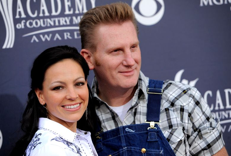 """FILE – In this April 3, 2011 file photo, Joey Martin Feek, left, and Rory Lee Feek of """"Joey + Rory"""" arrive at the 46th Annual Academy of Country Music Awards in Las Vegas, Nev. The husband-and-wife duo are releasing a new album of hymns in February, including a song the couple recorded while Joey was undergoing treatment for cervical cancer.  The album """"Hymns That Are Important to Us,"""" will be available on Feb. 12. (AP Photo/Chris Pizzello, File)"""